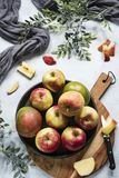 Mango and apples on black plate, cutting board stock image