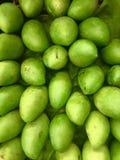 Mango aufgestellt für Verkauf Bilder von den grünen Früchten benutzt als Hintergrund Wiederholungs-Muster grafische Wiederholung  lizenzfreies stockbild