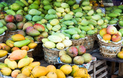 Mango background. Baskets with miscellaneous sort mango in street shop in vietnam Royalty Free Stock Photos
