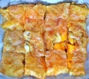 Mango, banana, ananas con il rotee dell'uovo Immagini Stock