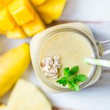 Mango, Banana, Pineapple and Oatmeal Smoothie in the Jar. With Ingredients nearby on the Light Background. Top View Royalty Free Stock Photos
