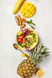 Mango banana pineapple turmeric smoothie bowl Stock Image