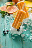 Mango banana popsicles on ice. With fresh fruits and berries Stock Photo