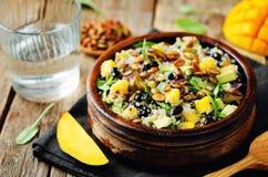 Mango black bean arugula pumpkin seed quinoa salad royalty free stock photos