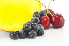 Mango, Blackberries and Cherries. Freshly sliced Mango, Blackberries and Cherries isolated on white Stock Images