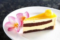 Mango cake. A dessert cake with mango on the plate Royalty Free Stock Photo