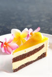 Mango cake. A cake with mango on the plate Royalty Free Stock Photo