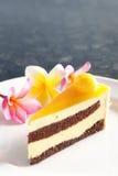 Mango cake. A cake with mango on the plate Royalty Free Stock Photo