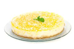 Mango cheesecake. Delicious cheesecake with mango decorated with mint isolated on white Stock Image