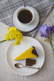 Mango cheesecake slice with coffee cup 1 Royalty Free Stock Photography