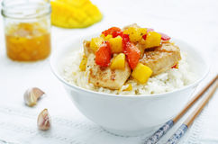Mango chicken stir fry with rice Royalty Free Stock Photo