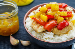 Mango chicken stir fry with rice Stock Photos