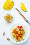 Mango chicken stir fry with rice Royalty Free Stock Photos