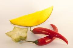 Mango, chili and carambola. On white isolated background Royalty Free Stock Images