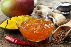 Mango Chutney. Bowl of Mango Chutney on wooden table Royalty Free Stock Photography