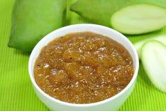 Mango chutney. With green mangoes on the background Royalty Free Stock Photos