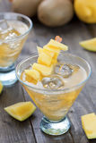 Mango cocktail. Cocktail of mango fruit on wooden table top with some slices of mango stock images