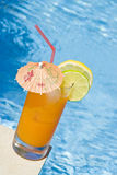 Mango Cocktail by the Pool Stock Photography