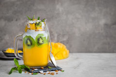Mango, coconut and chia seeds pudding in glass jar. Selective focus stock photo