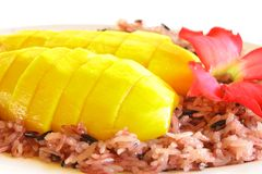 Mango and coconut cream black sticky rice Stock Image
