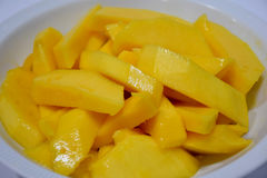 Mango cooked with water flower. Ripe mango with bright yellow flowers Royalty Free Stock Photos
