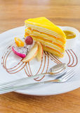 Mango crepe cake serve with mango sauce. And fresh fruit Royalty Free Stock Photos