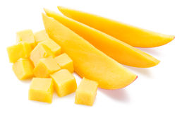 Mango cubes and slices. Isolated on a white. stock photography