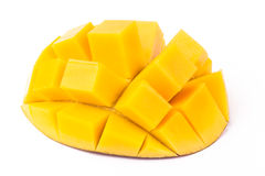 Mango Cubes On White. Mango slice cut to cubes close-up isolated on white background royalty free stock image