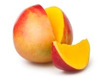 Mango cut. Slice on white background Stock Photos