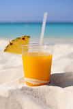 Mango daiquiri with pineapple on sandy beach Royalty Free Stock Photo