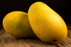 Mango on a dark wood background.  Stock Photo