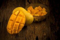 Mango on a dark wood background.  Stock Photography