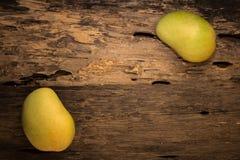 Mango on a dark wood background.  Stock Images