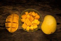 Mango on a dark wood background.  Royalty Free Stock Images