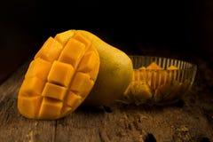 Mango on a dark wood background.  Royalty Free Stock Photo
