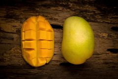 Mango on a dark wood background.  Stock Photos