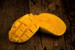 Mango on a dark wood background.  Royalty Free Stock Photography
