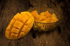 Mango on a dark wood background.  Royalty Free Stock Photos