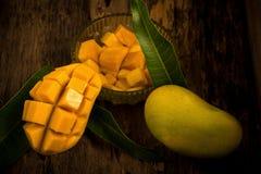 Mango on a dark wood background.  Royalty Free Stock Image