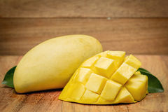 Mango on a dark wood background. tinting. Royalty Free Stock Image