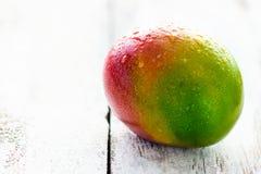 Mango. Delicious mango on the wooden background Royalty Free Stock Image