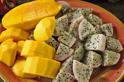 Mango and dragon fruit. Pieces of ripe mango and dragon fruit Royalty Free Stock Images