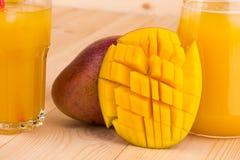 Mango e succo Immagine Stock