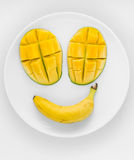 Mango face on a plate. Royalty Free Stock Photography