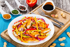 Mango, fried chicken breast cutting in strips,  peanuts, pepper Royalty Free Stock Image
