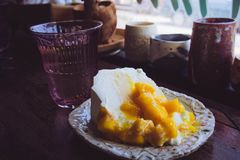 Mango fruit cake on wooden table in restaurant, cafe.  Royalty Free Stock Photo