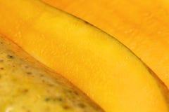Mango fruit closeup. Closeup of a mango fruit showing its juicy flesh Royalty Free Stock Images