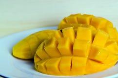 Mango fruit on the dish. Mango ripe with nicely cut arranged on the dish (Other names are horse mango, Mangifera foetida, Anacardiaceae, Mangifera, M. indica Royalty Free Stock Images