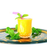 Mango fruit juice with mint in pure white background Royalty Free Stock Photos