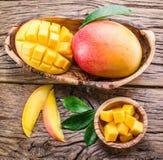 Mango fruit and mango cubes. Royalty Free Stock Photo